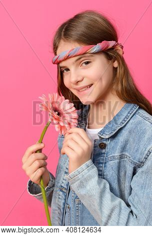 Girl 10 Years Old In A Denim Shirt With A Pink Gerbera Flower In Her Hands On A Pink Background, Tee