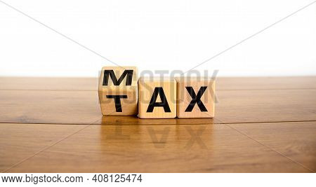 Max Tax Symbol. Turned Wooden Cubes With Words 'max Tax'. Beautiful Wooden Table, White Background,