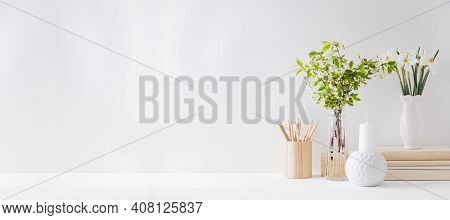 Home Office, Interior For Bloggers Workplace With White Daffodils In A Vase, Office Supplies On A Li