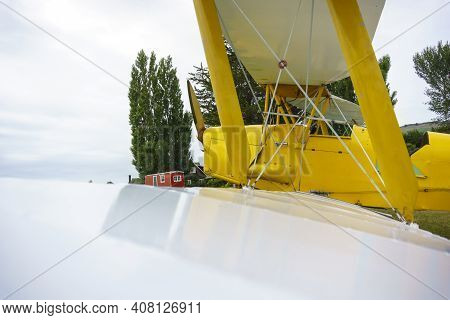 Yellow Biplane With White Wings Close Up Looking Along Wings