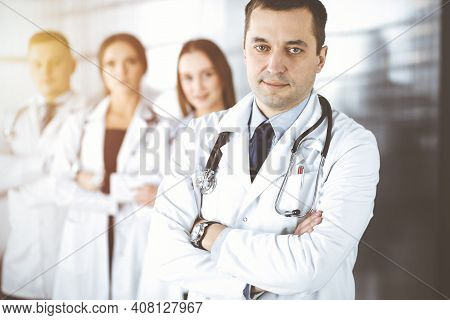 Group Of Professional Doctors, Standing As A Team With Crossed Arms In A Sunny Hospital Office, Read