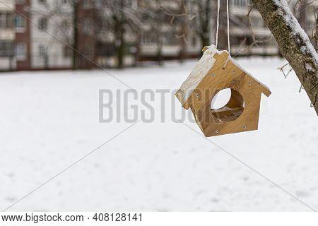 Bird Feeder. Winter Background. Empty Bird Feeder In Winter On A Snow Background. Copy Space.