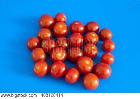 Ripe Cherry Tomatoes On The Blue Background