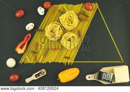 Background Layout For Cooking, Pasta And Vegetables, Spread Out On The Table. Different Types Of Pas