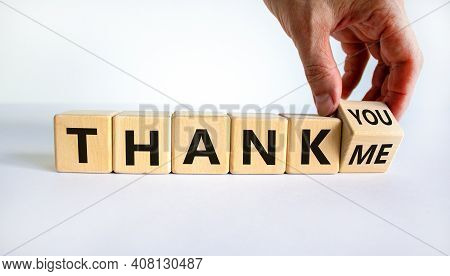 Thank You Or Me Symbol. Businessman Turns A Cube And Changes Words 'thank Me' To 'thank You'. Beauti
