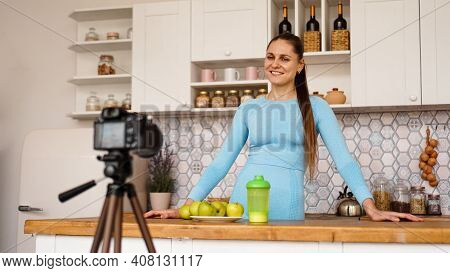 Satisfied Healthy Young Girl Recording Her Video Blog Episode About Healthy Food While Standing At T