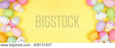 Colorful Easter Egg Double Border Over A Soft Yellow Wood Banner Background. Top View With Copy Spac