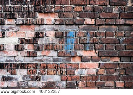 Colourful Brick Wall Detail Texture Background. Old Weathered And Cracked Red, Orange, Brown And Gre