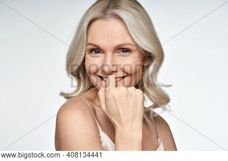 Happy Smiling Attractive 50s Middle Aged Blonde Woman Looking At Camera Advertising Antiage Face Ski