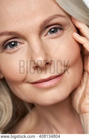 Happy Attractive 50 Years Old Middle Aged Mature Woman Touching Healthy Soft Face Skin Looking At Ca
