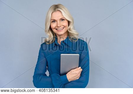 Happy Elegant Middle Aged Older Professional Business Woman Leader, Consultant Manager, Looking At C