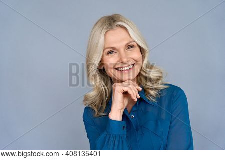 Smiling Sophisticated 50s Middle Aged Blond Business Woman Looking At Camera. Happy Mature Elegant O