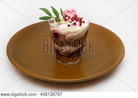Trifle Portioned Mini Cake On Plate. Layered Trifle Dessert With Whipped Cream And Chocolate Hearts