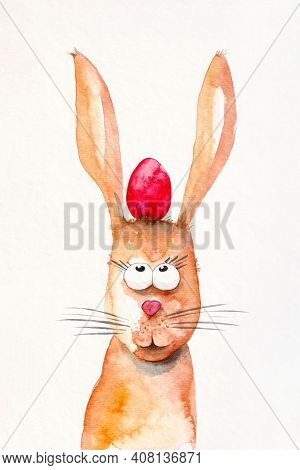 A watercolor illustration of a easter rabbit with a red egg between the ears