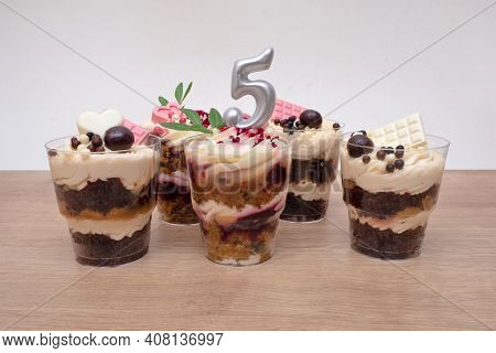 Birthday Trifle Cake With Candle Labeled Number 5. Five Portioned Mini Cakes
