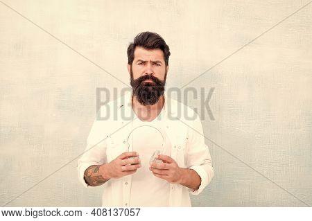 Bearded Man Headphones Light Background. Hipster Listen Music Stereo Headphones. Modern Wireless Hea