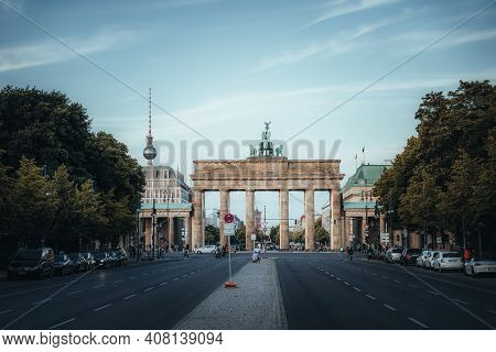 Berlin, Germany - Feb 10, 2021: Street View Towards Brandenburg Gate In Berlin With Tv Tower And Cit