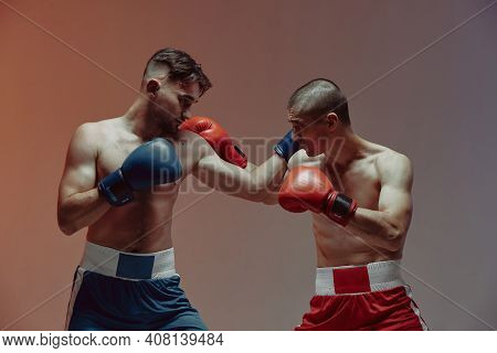 Boxers Combat Of Two Fighting Males In Boxing Gloves In Red Studio Light, Martial Arts, Mixed Fight