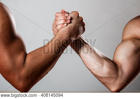 Hand Wrestling, Compete. Hands Or Arms Of Man. Muscular Hand. Clasped Arm Wrestling. Two Men Arm Wre