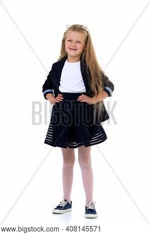 Blonde Girl In School Uniform. Cute Long Haired Schoolgirl Wearing Blue Jacket And Skirt Standing Wi