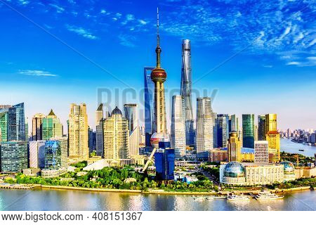 Shanghai City Skyline With Huangpu River. Pudong Business District In Shanghai, China With Blue Sky