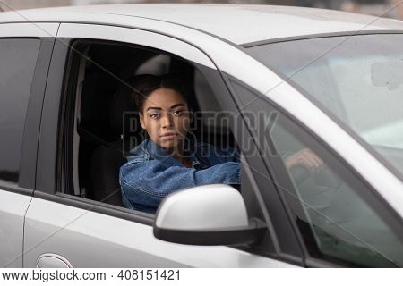 Good Serious Driver And Right Hand Traffic. Sad Tired Young African American Woman Holds Steering Wh