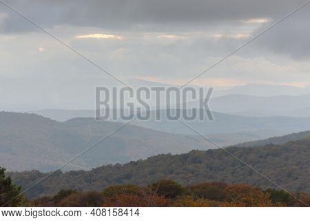 Calm Autumn Landscape. Beige Haze In The Mountains. Fantastic Light Fog At Sunset. Atmospheric Autum