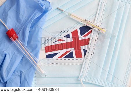 On Table Lies The British Flag, Medical Protective Masks And Test For Taking Biological Material. Br