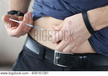Man Injects Himself In Stomach With An Injection Of Insulin. How To Properly Give Yourself Subcutane