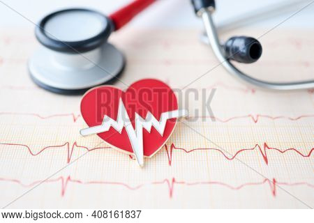 On Table Lies Stethoscope Cardiogram And Heart Sign. Heart And Vascular Disease Concept