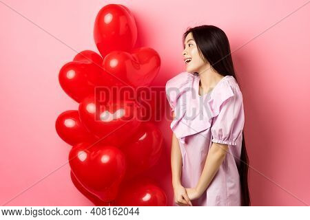 Romance And Love Concept. Romantic Asian Girl Looking With Affection And Sympathy At Empty Space, St