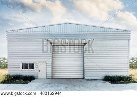 Steel Shutter Roller Door Of Factory Warehouse Workshop For Materials Storage, Front View Of Rolling