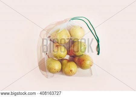 Reusable Packaging Of Products By Weight. Pears In A Reusable Bag Close Up On A Pink Background