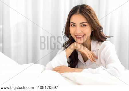Portrait Of Smiling Cheerful Beautiful Pretty Asian Woman Clean Fresh Healthy White Skin Posing In P