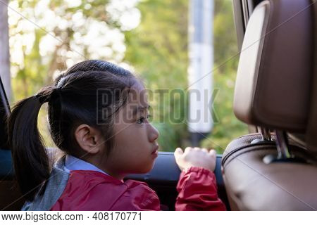 Asian Happy Student Smiling With Camera While Enjoying Road Trip In Car. Daughter Smiling And Lookin