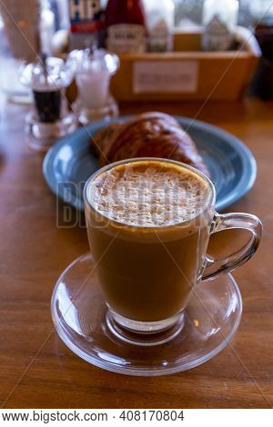 Close Up Hot Cappuccino, Latte, Caramel Macchiato On Table With Blur Coffee Shop Background. Hot Cap