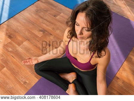 Young Woman, Fitness Instructor In Sportswear Leggings And Tops, Stretching In The Gym Before Pilate