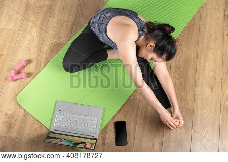 Woman In Sportswear Make Remote Yoga Exercise Yoga Class. Woman Do Fitness Workout, Stretching Exerc