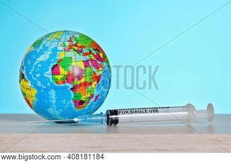 Vaccination Of The World Against Coronavirus. Vaccination Concept Covid 19. Syringe With Vaccine.