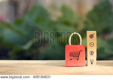 Online Shopping Concept: Arranging Wood Cube Block Stacking With Icon Business Strategy And Shopping