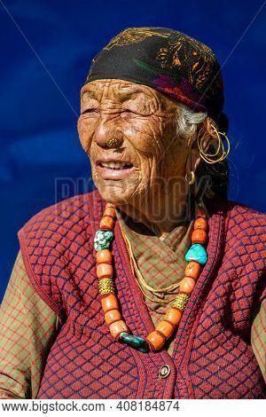 GHANDRUK, NEPAL - CIRCA NOVEMBER 2013: Portrait of an elderly Nepali Gurung woman.