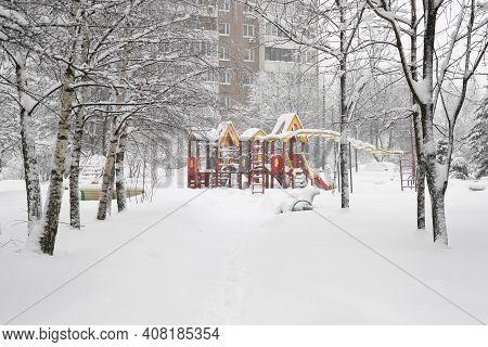 Yard With Childrens Playground During Heavy Snow In Russia