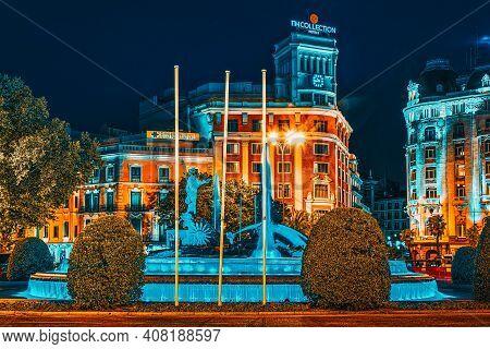 Neptune Fountain (fuente De Neptuno) And The Westin Palace Hotel