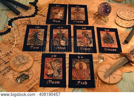 Witch Table With Tarot Cards And Magic Ritual Objects.  Esoteric, Gothic And Occult Background, Hall