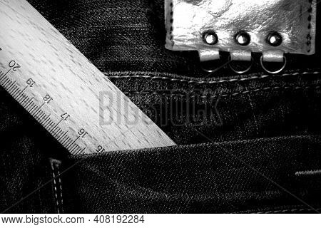 Old Jean Pant And Wooden Ruler On Pocket
