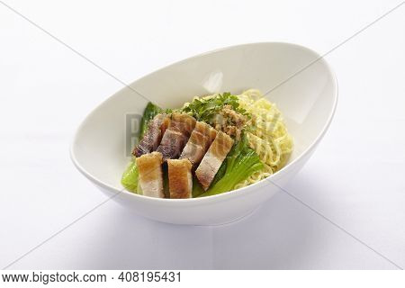 Egg Noodle With The Red Roasted Pork In The White Bowl On White Background, Thai Style Food.