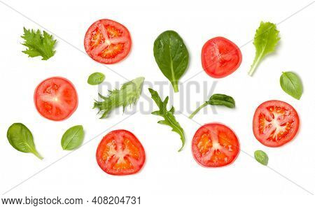 Creative layout made of tomato slices and lettuce salad leaves. Flat lay, top view. Food concept. Vegetables isolated on white background. Food ingredients pattern.