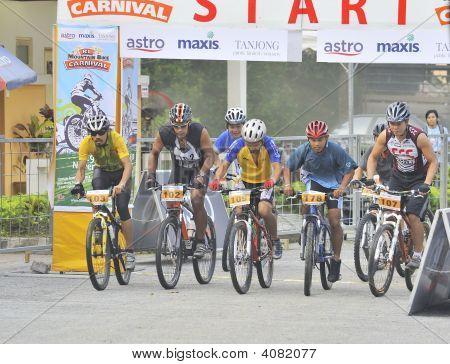 Mountain Bike Racer At The Start Line.