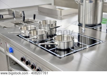 Stainless Steel Pots Built On The Stove In The Restaurant Kitchen