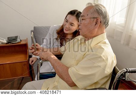 Asian Senior Man Was Sick And Sitting On Wheelchair. The Doctor Check Retirement Age Health At Home.